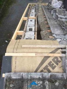 Assessing the damaged membrane and roof lats
