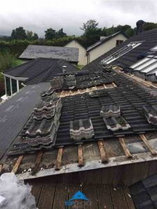 Start of repairing the roof by removing tiling