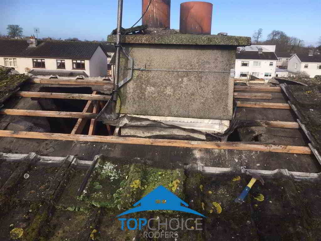 Old Tiles Removed To Repair Roof Chimney