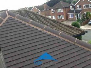 Ridge tiles re-bedded in cement