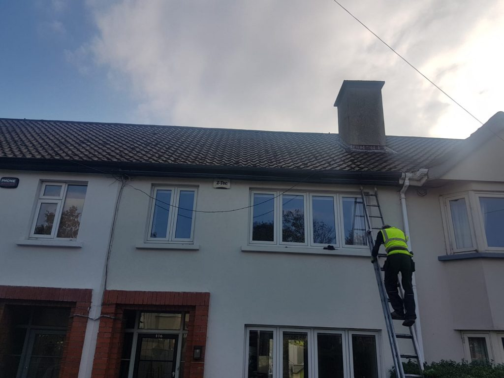 Team member doing gutter repairs