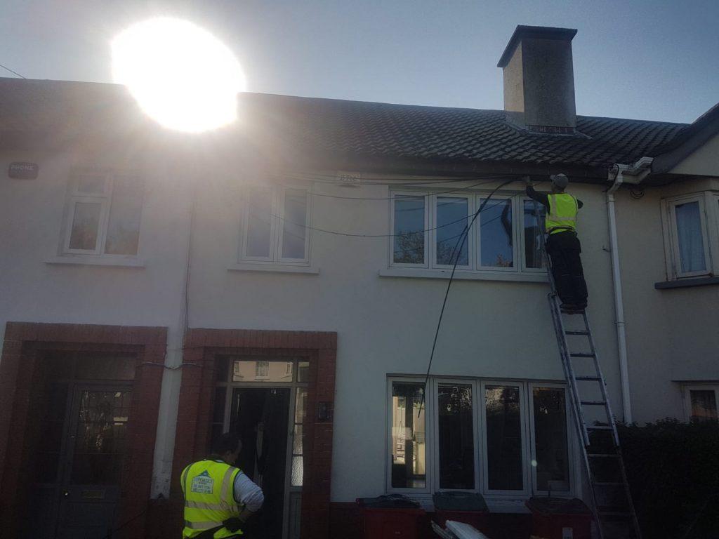 Team member doing gutter repairs