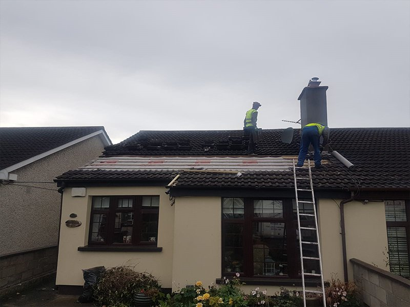 Roof being repaired after damage